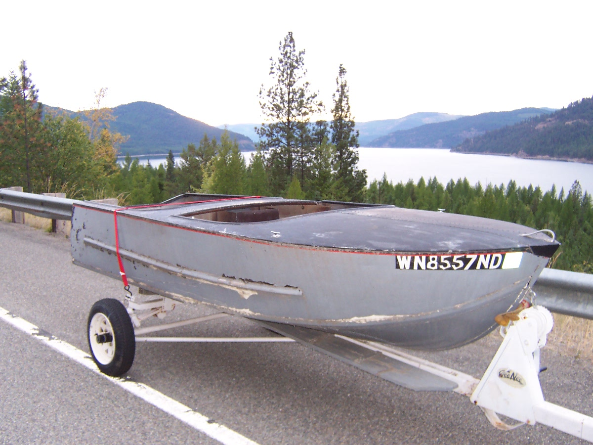 Help, History of an obscure riveted runabout    Boat Design Net