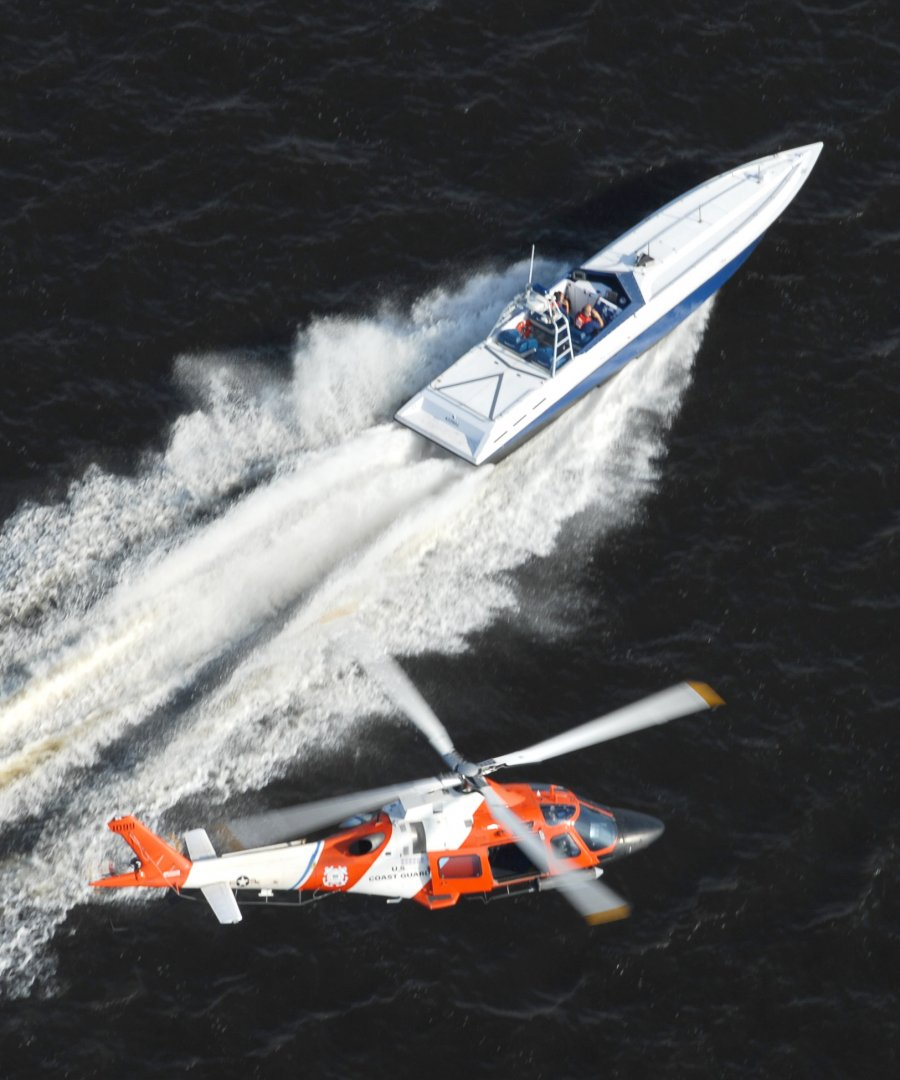 Go-fast boat and U.S. Coast Guard Helicopter.jpg